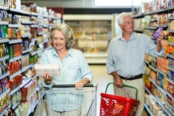 Smiling senior couple buying food
