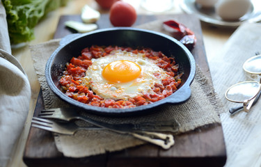 Foto op Canvas Gebakken Eieren scrambled eggs with tomatoes