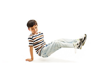 Isolated boy fall down on white background