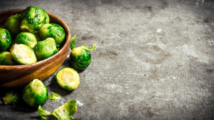 Brussels sprouts are in the Cup on stone table.