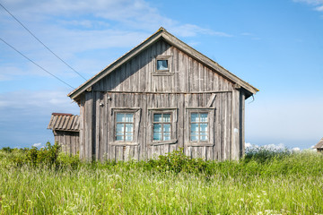 Abandoned weathered wooden house exterior