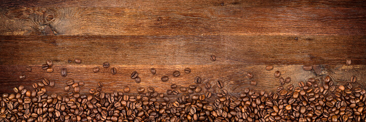 Poster de jardin Café en grains coffee background with beans on rustic old oak wood