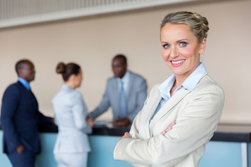 businesswoman standing at hotel reception