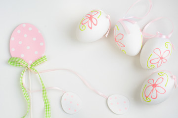 Easter pastel eggs on white background. Top view.