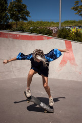 Urban girl skating in a skatepark.