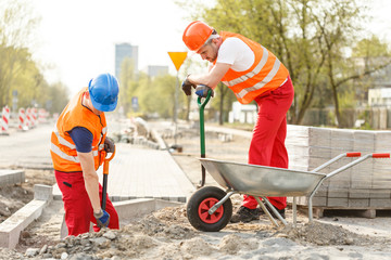 Labourers digging on road construction