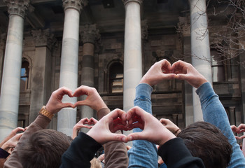 Hands. Supporters of Australian Equal Marriage Rights gather outside of South Australia Parliament House.