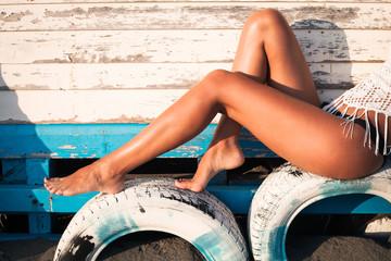 tanned woman legs