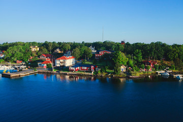Beautiful super wide-angle panoramic aerial view of Stockholm archipelago, Sweden with harbor and skyline with scenery beyond the city, seen from the ferry, sunny summer day with blue sky