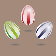 Set eggs with stripes  A set of three eggs with white stripes on pastel background with a clear shadow