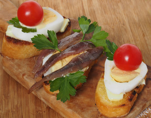 Crostini with anchovy end egg - small sandwich