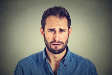 Portrait of a sad young man.