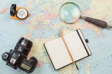 Planning and preparation of travel with map and glass magnifier
