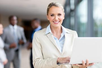 mature businesswoman using laptop computer