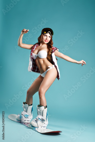 Attractive Young Sexy Girl In Bikini Holding Balance On Snowboard On