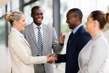 african man introducing businesswoman to business partners