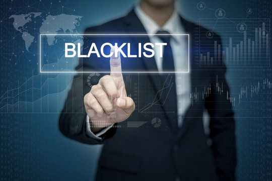 Businessman hand touching BLACKLIST  button on virtual screen
