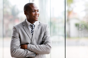 black businessman looking outside window