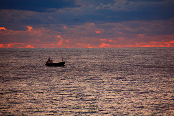 The ship on the Black Sea at sunset.