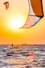 Kite-surfing at sunset