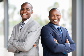 african businessmen with arms crossed