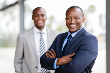african businessman standing in front of colleague