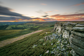 Orange sunset at Stanage Edge in the Peak District, UK. Wall mural