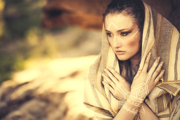 beautiful young woman standing in ancient dress