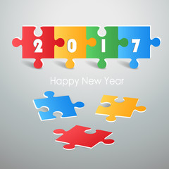 Design colorful puzzle, Happy new year 2017 greeting card