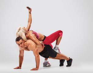man doing push ups but woman selfie