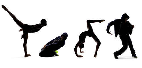 Silhouettes of dancers posing with classical ballet and modern hip hop dance