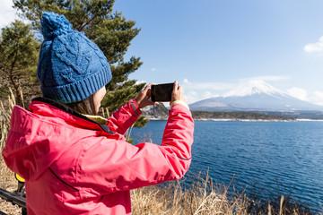 Woman take the photo on Mt. Fuji
