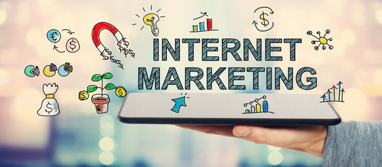 Internet Marketing concept with man holding a tablet