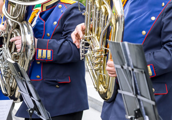 musicians playing tuba in street orchestra