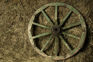 the wheel of the cart in a haystack