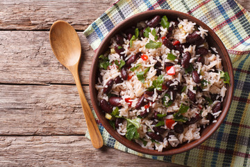 Rice with red beans and vegetables in a bowl. horizontal top view