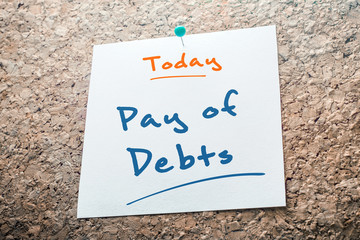 Pay of Debts Reminder For Today On Paper Pinned On Cork Board