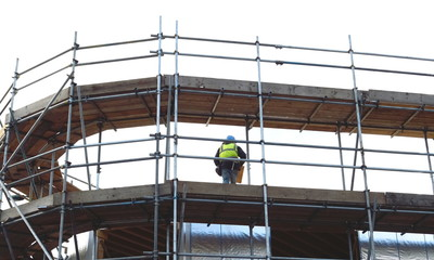 Scaffolding with worker on a platform