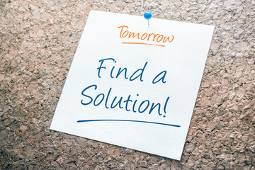Find a Solution Reminder For Tomorrow On Paper Pinned On Cork Board