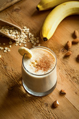 Banana smoothie with cinnamon, peanut butter and oat flakes. Healthy vegan breakfast