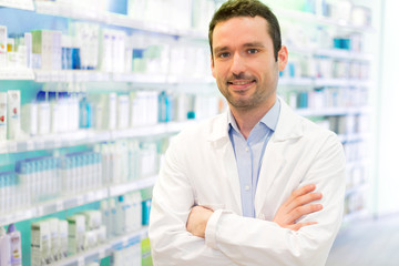 Young Attractive pharmacist at work