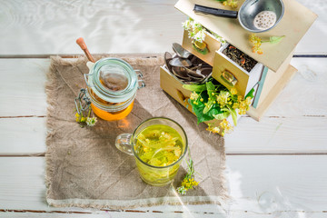 Healthy linden tea with honey in summer day