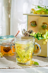 Sweet tea with honey in summer day