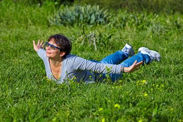 woman lying on a green grass