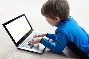 Boy working on laptop computer