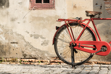 Red bike beside the old city walls