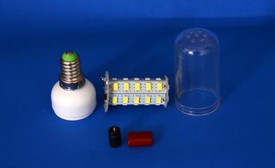 disassembled energy saving LED light bulb on a white background