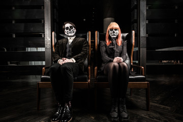 Evil day of the dead undead couple in chairs