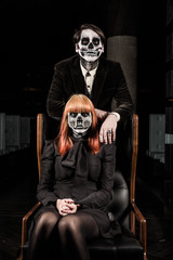 Evil day of the dead undead couple in chair