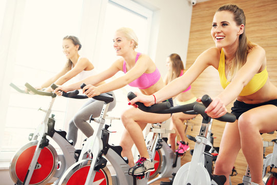 Sporty women on spinning class